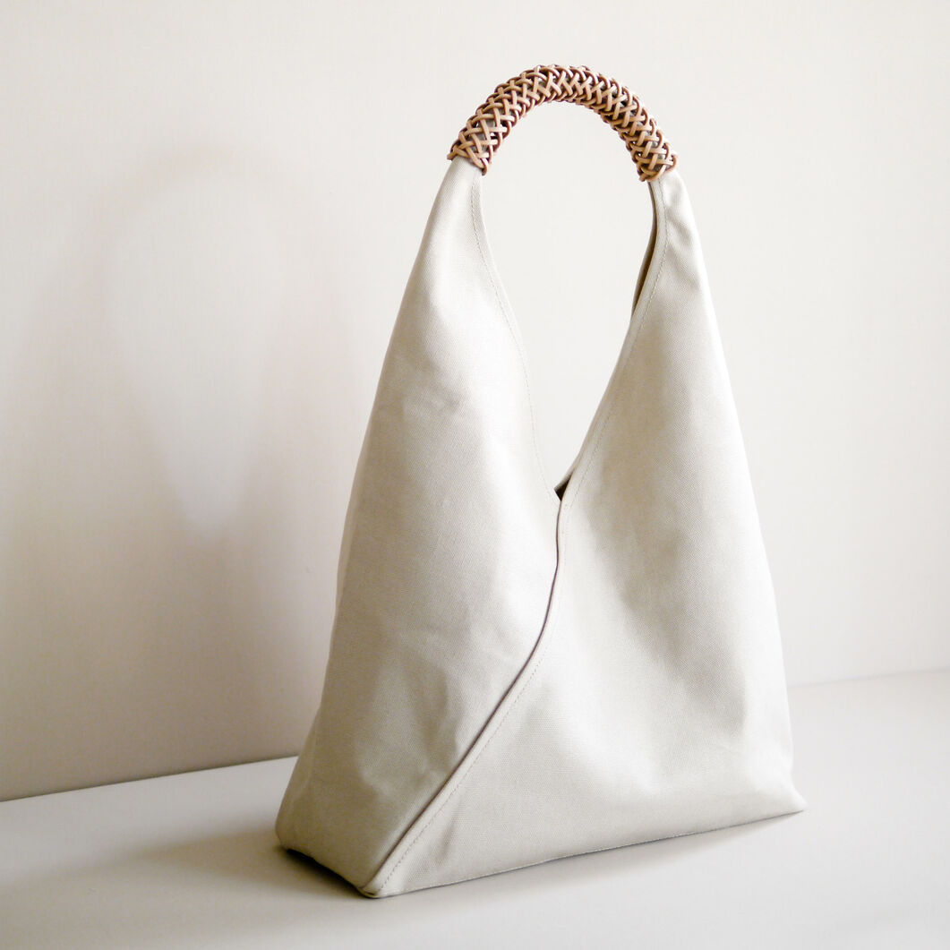 Woven Triangle Bag in color Ivory