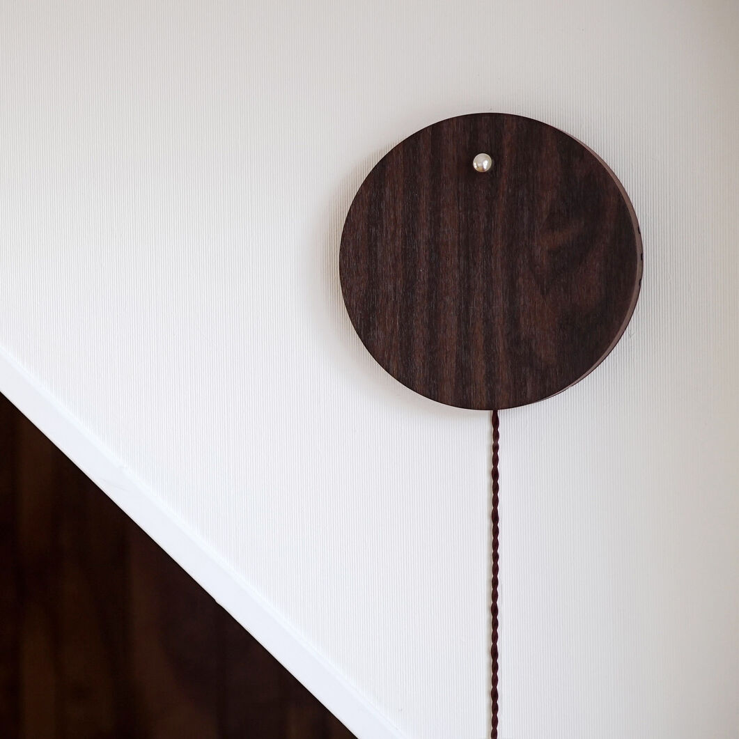 Story Clock in color Walnut