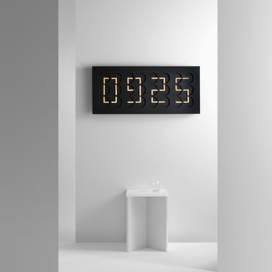 ClockClock 24 Golden Hands – Black in color