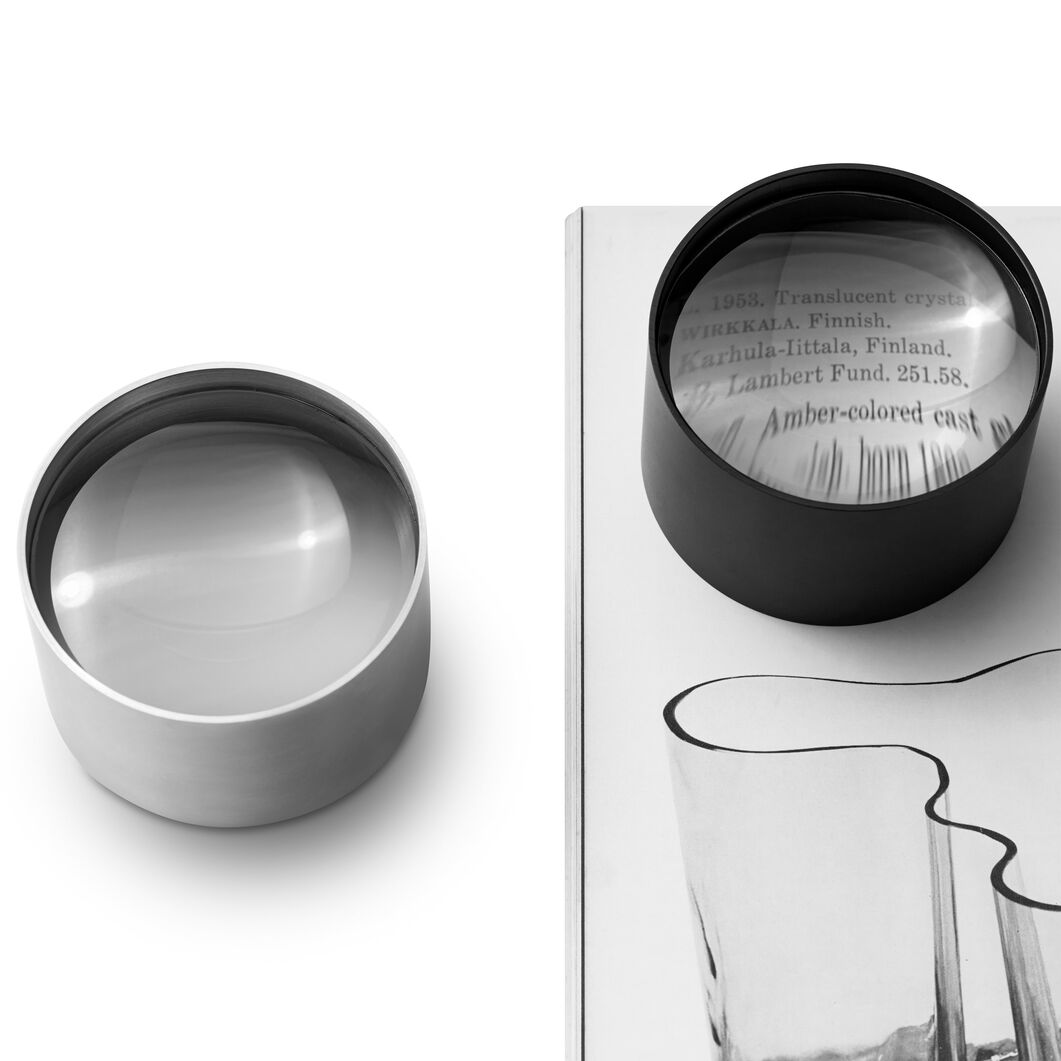 Page 1 Magnifier + Paperweight - Black in color