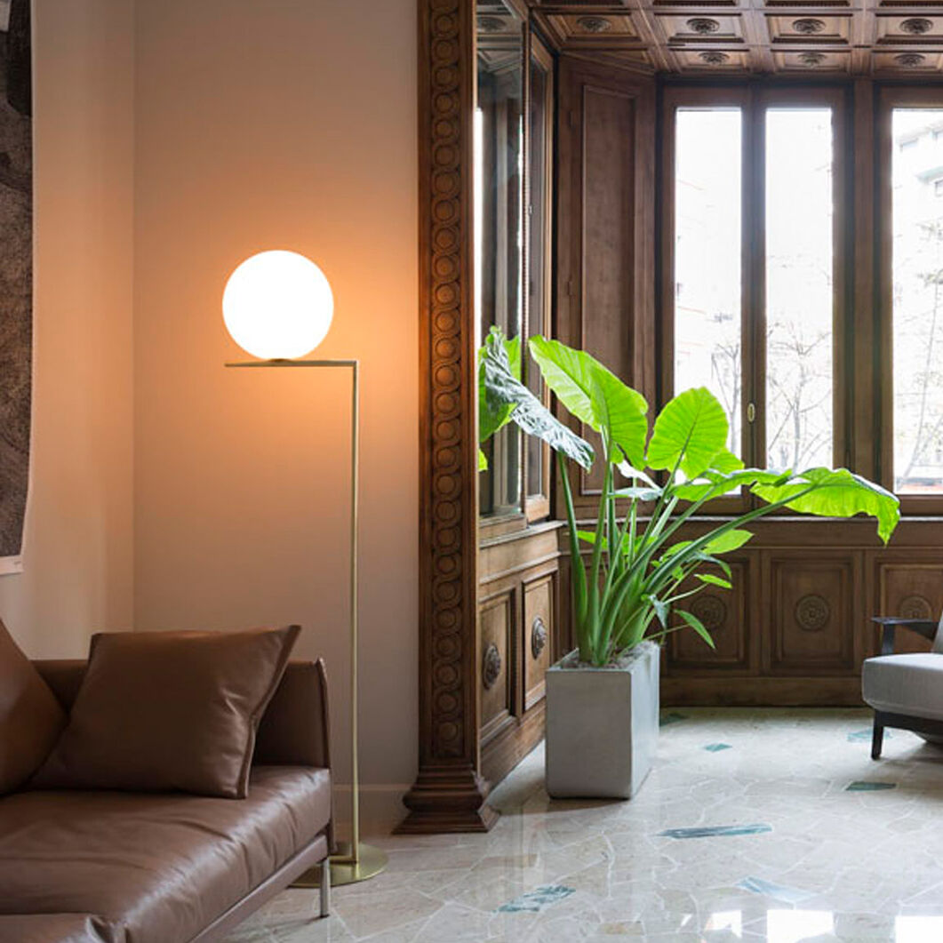 IC F1 Floor Lamp, Brass in color